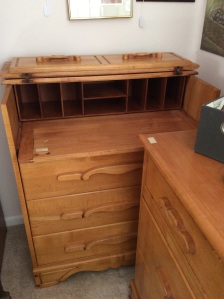 By day it's an ordinary dresser. At night the top folds up and it's anything goes.