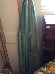 This is your mom's old ironing board. Not only is it uber sturdy, it's that great turquoise color!