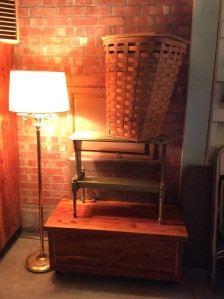Small cedar chest. And cute side table for books on top.