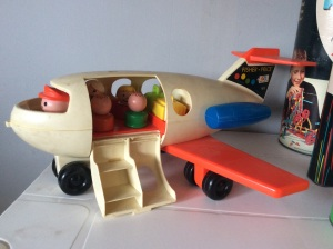 The Fisher-Price airplane! Check it out. All the people and their luggage is intact. That doesn't even happen with real airlines these days!