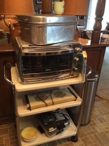 Sweet cart, roaster, toaster oven, and a very retro waffle maker.
