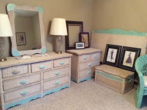 Pier One wicker with robin's egg blue metal trim. Sturdy, solid, and the drawers roll like butter. Excellent condition.