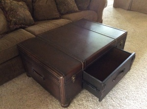 Stunning leather trunk-style coffee table with a drawer.