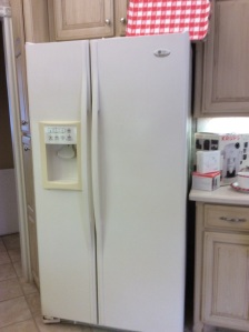 Counter-depth GE side by side refrigerator.