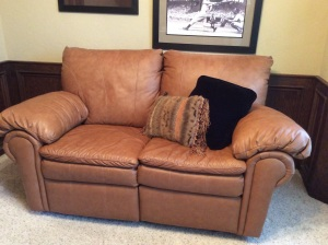 Leather loveseat recliner. Perfect for an office!