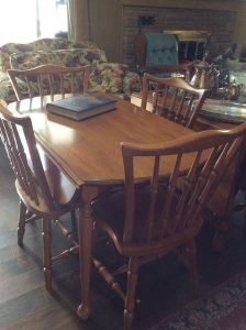 Another table with leaves that fold out. This one also has leaves for the center. Comes with six chairs.